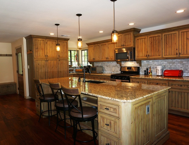 Full kitchen with large granite counter tops