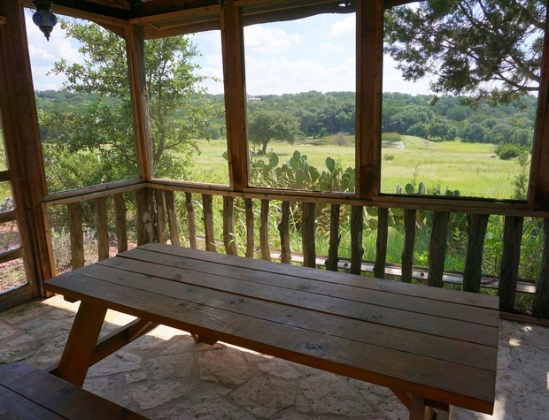 Picnic table in the screened dining area with amazing views!