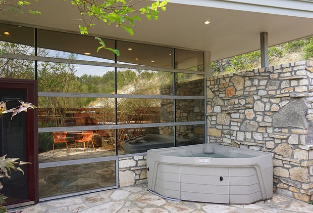 The hot tub is located right outside the master bedroom