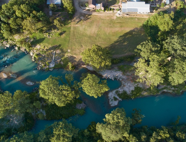 Aerial view of home situated along San Marcos River