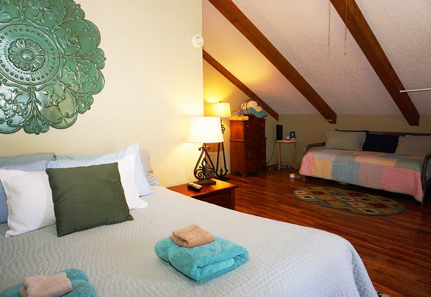 Spacious master bedroom also has a twin bed available.