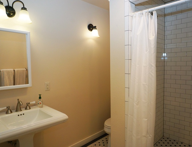 Bathroom in the separate suite with a standing shower