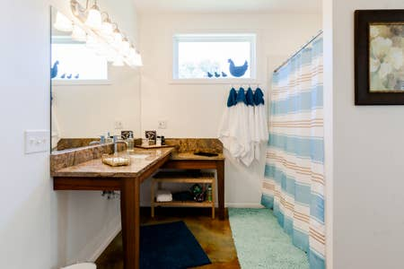 Large rainwater shower is directly behind the vanity.