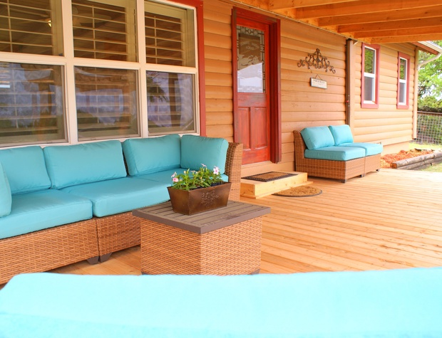 Cozy back porch with lots of conversation seating.