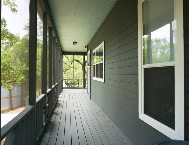 A wraparound screened porch provides a charming entry to the home
