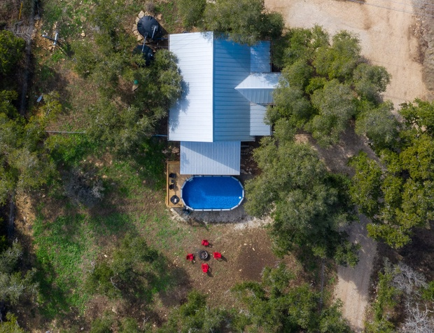 Aerial view showing the location of the fire pit in relation to the pool.