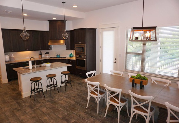 Open floor plan with adjoining kitchen and dining and living area.