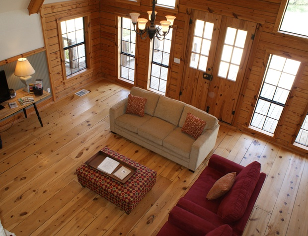 View of the living room from the upstairs loft