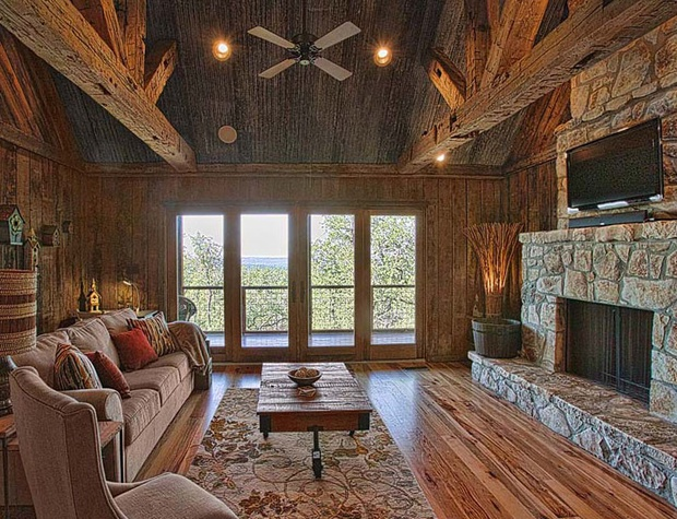 Cozy up next to the gorgeous stone fireplace while still enjoying spectacular views!