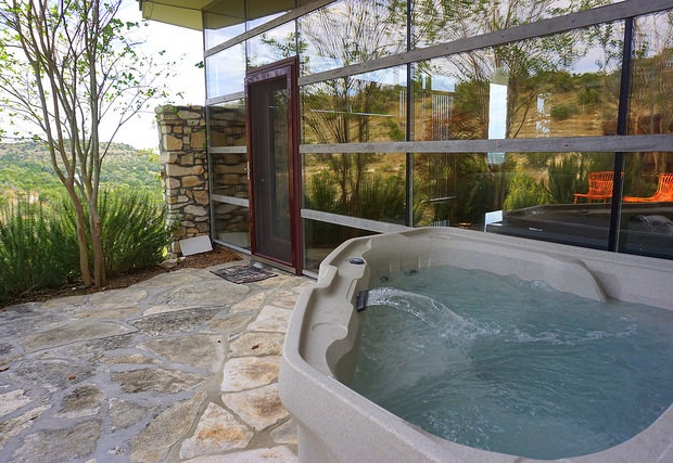 The freestanding hot tub is just off the master suite
