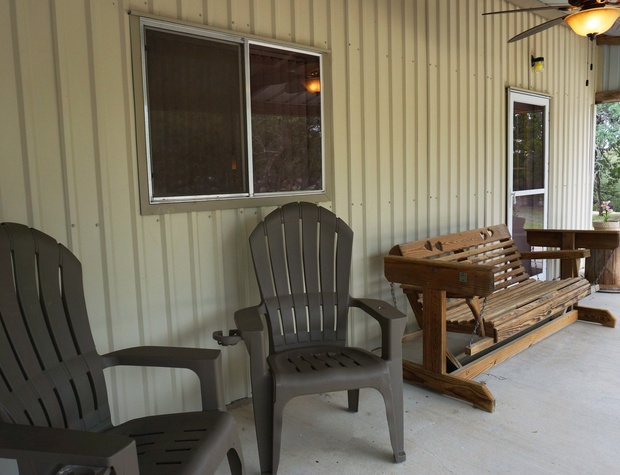 Slider and seats on front porch.