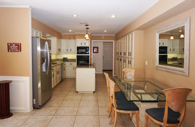 Full kitchen with another dining area