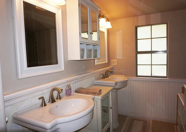 Split vanities in guest house bathroom