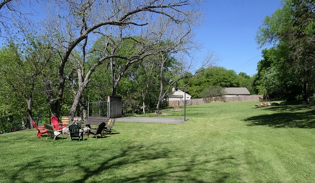 Looking down the grounds at the fire pit, basketball goal, and horseshoe pit.