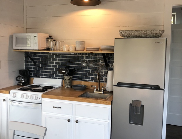 Kitchen with range, oven, microwave, and refrigerator.