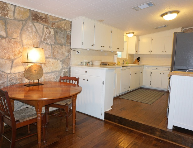 Full kitchen off the living area with small breakfast nook.