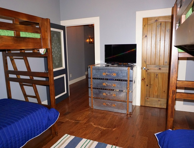 The 3rd bedroom is at the end of the hall and has a private TV as well.