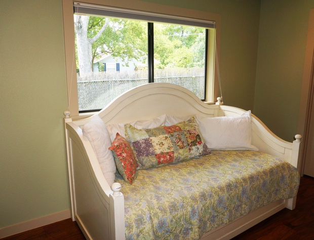 This bedroom also has a large day bed