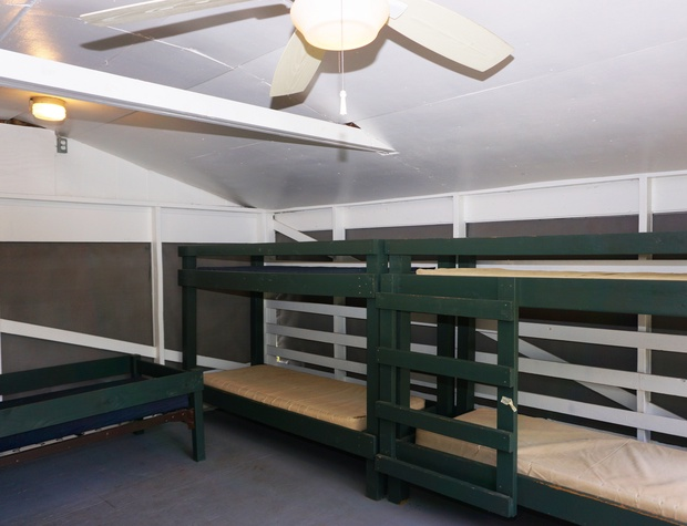 Cabin interior with multiple bunk beds