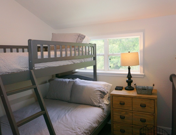 Twin top bunk bed with Full bed on bottom