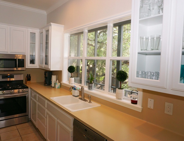 Beautiful window over the sink with lots of counter space.