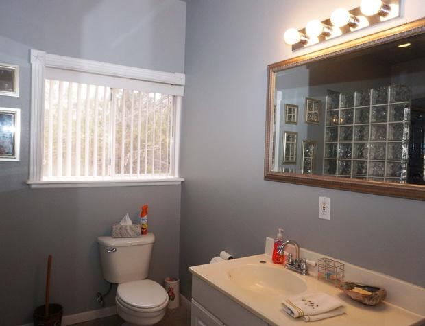 Bathroom has single vanity.