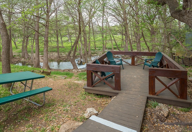 Newly built deck and chairs by the creek