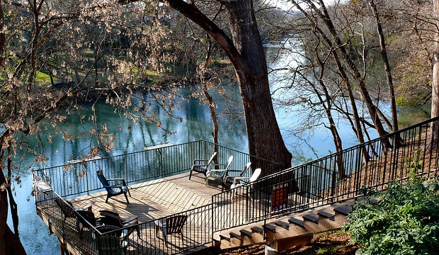Deck behind home overlooking the Guadalupe river.