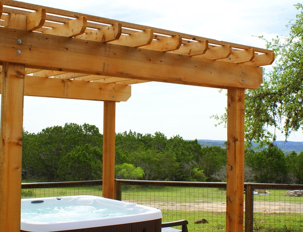 The hot tub with pergola also boasts fantastic views!