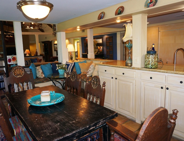 Dining table is right next to the gourmet kitchen