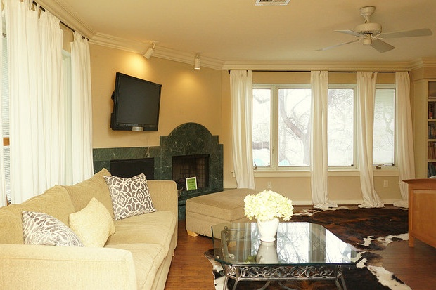 Master suite has private sitting area and large TV with a decorative fire place.