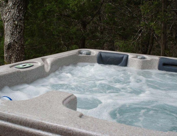 Soak in the private hot tub under the stars.