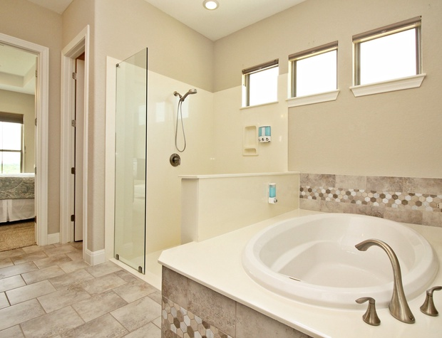 Large soaking tub and standing glass shower