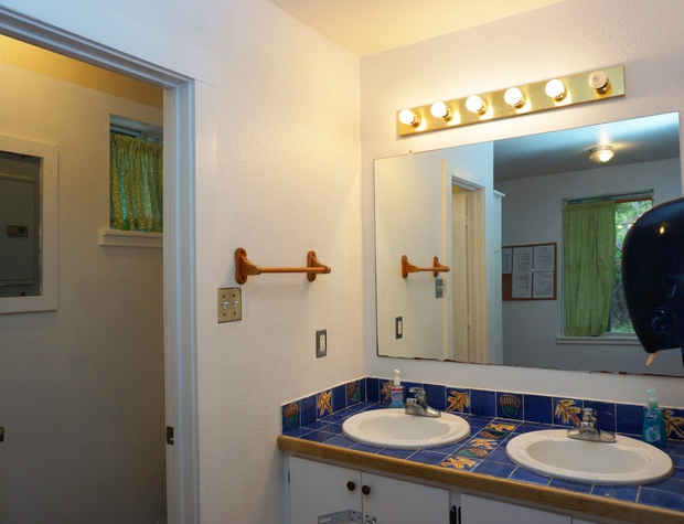 one of two vanity areas - each section has a shower and toilet as well as vanity area.