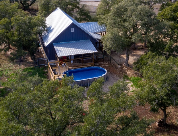 Aerial view of home with Private pool, covered deck and spa.