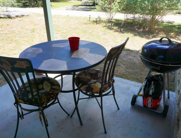 Front patio with a table and grill
