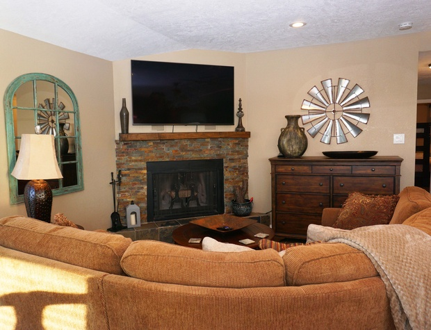 Cozy up in front of the wood-burning fireplace and/or large streaming TV.