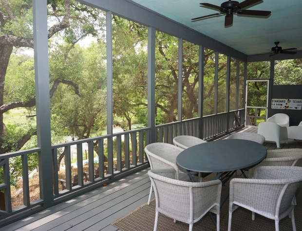 Enjoy the breeze on the expansive covered porch