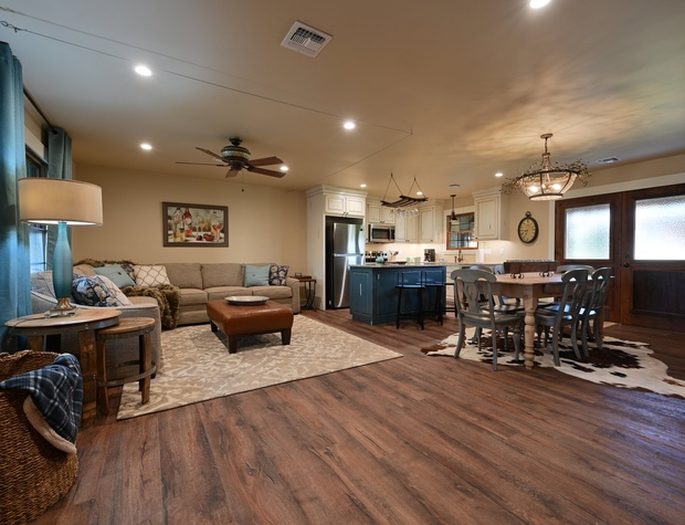 Open floor plan with dining, kitchen and living area.