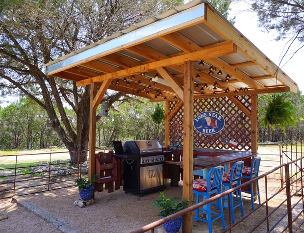 The covered outdoor kitchen is the perfect gathering spot.