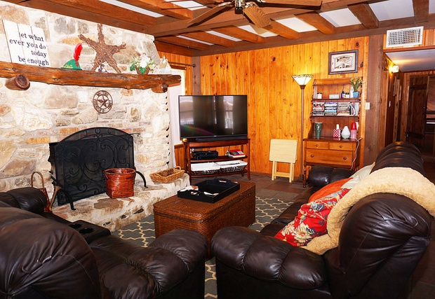 Comfortable living area with stunning wood burning fireplace!