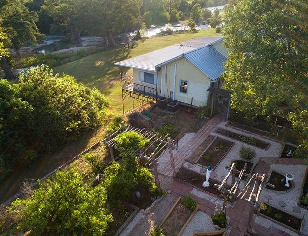 House and garden looking toward San Marcos River