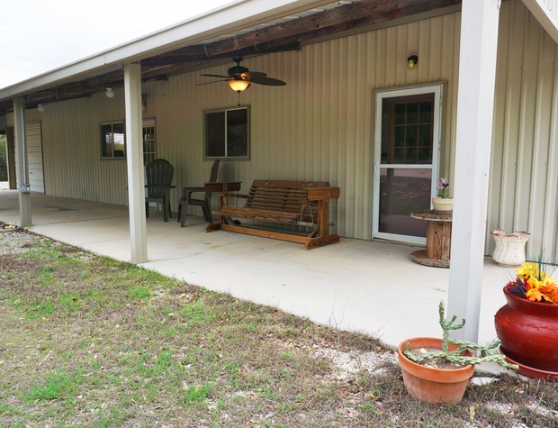The front porch has seating and is perfect to enjoy you morning coffee.