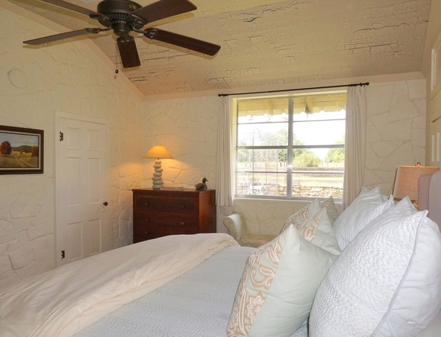 Master bedroom has lovely views and luxurious linens.