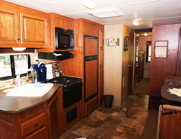 Sink, Range, and microwave in galley kitchen