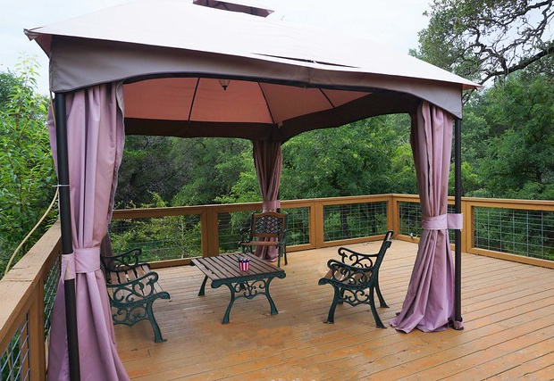 Covered seating area overlooking the creek