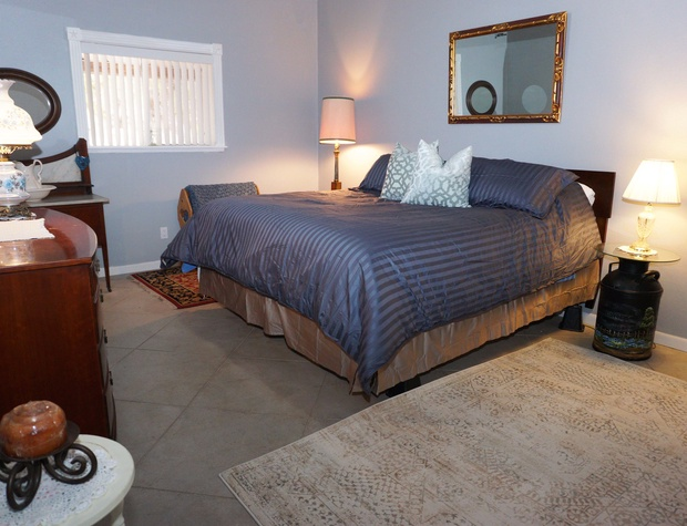 Master bedroom has a King sized bed.