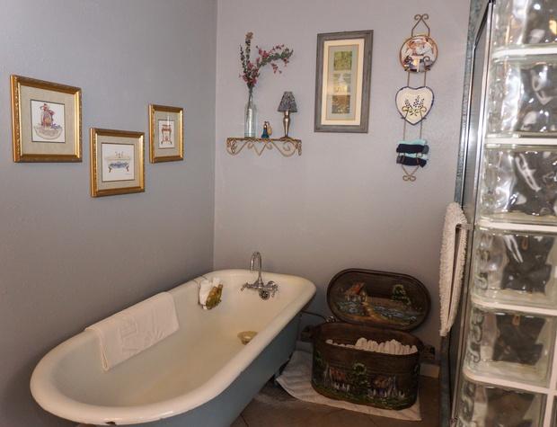 The bathroom has a bathtub and walkin shower.