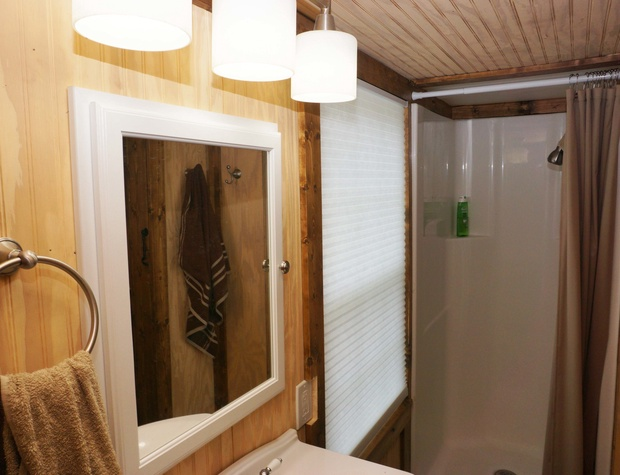 Bathroom area with shower.