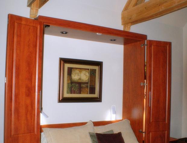 Queen sized murphy bed in study/bedroom